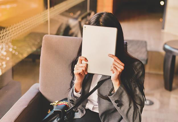 Businesswoman hidding her face