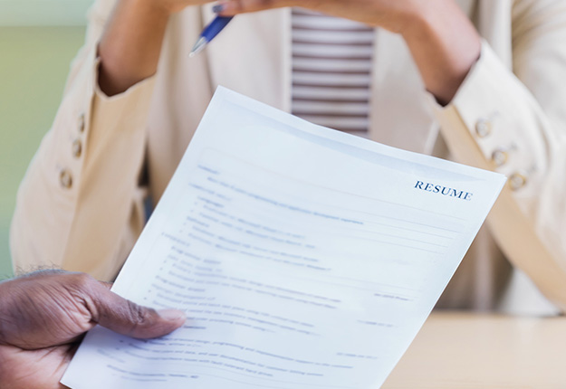 Man holding resume in an interview