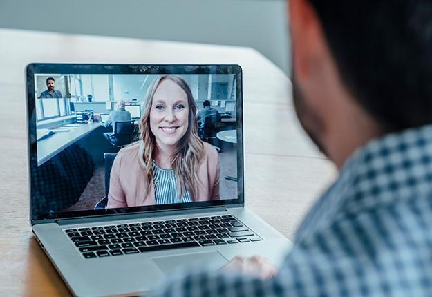 Man talkin to woman through laptop