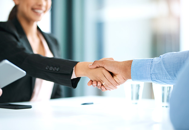 Business man and women happily shaking hands