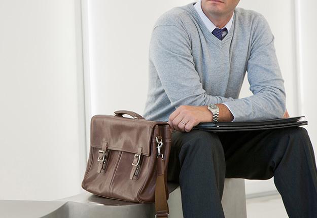 Businessman sitting down with briefcase