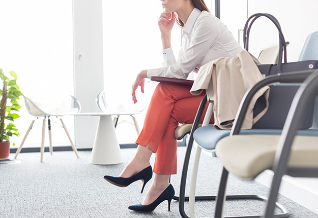 Businesswoman waiting in lobby sitting down
