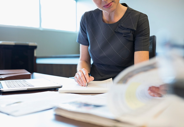 Woman attorney reading papers