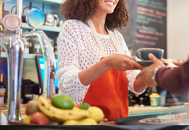 Woman working as a cashier in a coffee shop