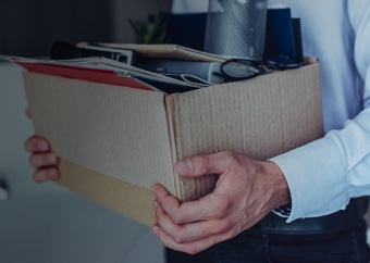 Businessman carrying a box with all of his office belongings
