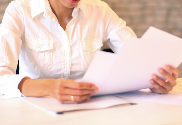 Woman looking at resume pages