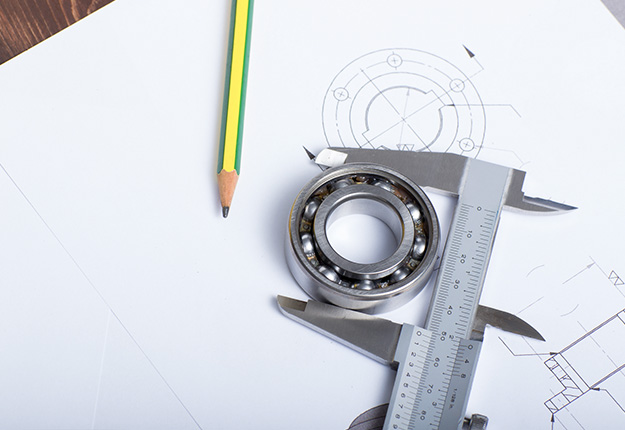 Caliper holding a bearing on a technical drawing