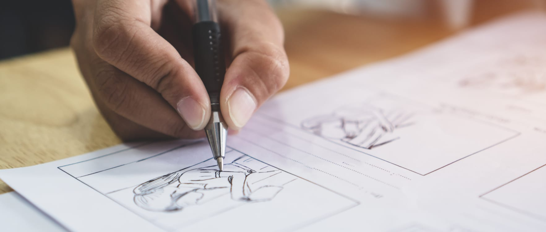Male hand drawing a storyboard