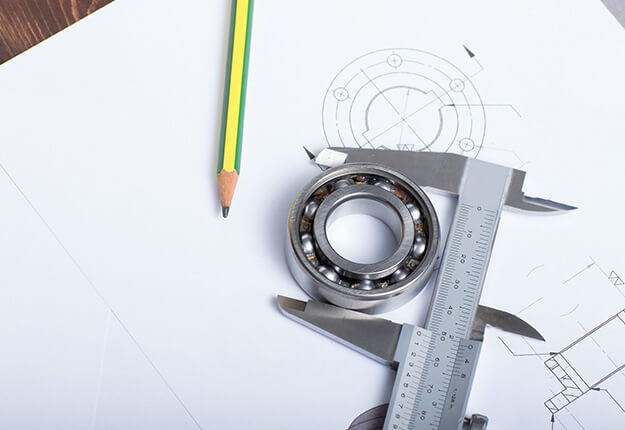 aliper holding a bearing on a technical drawing