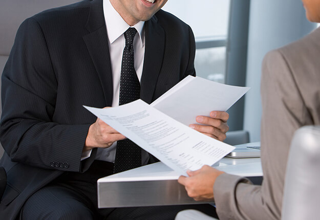 Man and woman in an interview holding resume