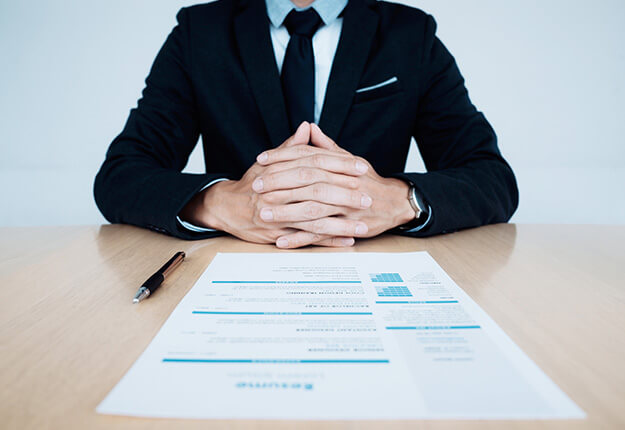 Businessman with resume on table