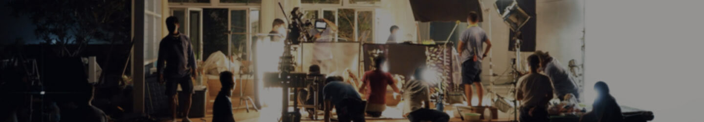 Production crew setting up a scene at a filming set