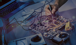 Engineer using a current meter on a motherboard