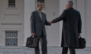 Two government men shaking hands